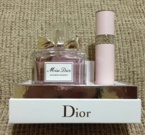 Miss Dior Blooming Bouquet with its travel size spray bottle